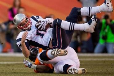 Terrance Knighton toppled Patriots quarterback Tom Brady on a fourth-down play in Denver on Sunday.